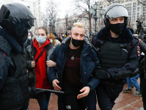 Russian police detain protesters during a demonstration against the jailing of opposition leader Alexei Navalny in Moscow (Pavel Golovkin/AP)