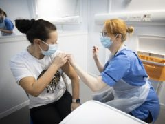 Nurse Eleanor Pinkerton administers a coronavirus vaccine to one of the health and social care staff at the NHS Louisa Jordan Hospital in Glasgow (PA)
