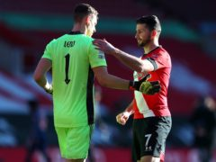 Arsenal goalkeeper Bernd Leno (left) and Southampton's Shane Long after the final whistle (Catherine Ivill, PA)