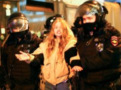 Police detain a woman during a protest against the jailing of opposition leader Alexei Navalny in Moscow (AP)