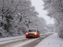 Cars make their way along along a snow lined Melton Road in Six Hills, Leicestershire. Picture date: Sunday January 24, 2021.