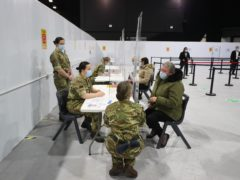 Military personnel at the Winter Gardens in Blackpool, which has been converted for use as a Covid vaccination centre (Peter Byrne/PA)