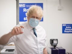 Prime Minister Boris Johnson on a visit to a vaccination site at Barnet Football Club in north London (Stefan Rousseau/PA)