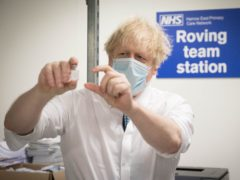 Prime Minister Boris Johnson sees how a dose of the Oxford/Astra Zeneca Covid 19 vaccine is prepared for a mobile vaccination centre at Barnet FC's ground at The Hive, north London, which is being used as a coronavirus vaccination centre. Picture date: Monday January 25, 2021.