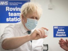 Prime Minister Boris Johnson sees how a dose of the Oxford/Astra Zeneca Covid 19 vaccine is prepared for a mobile vaccination centre at Barnet FC's ground at The Hive, north London (Stefan Rousseau/PA)