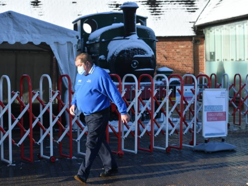 A man leaves after delivering doses of the Oxford/Astrazeneca coronavirus vaccine arrive at The Black Country Living Museum in Dudley. The open air museum, which has previously been used as a set for the BBC drama Peaky Blinders, is now being used as a covid vaccination centre. Picture date: Monday January 25, 2021.