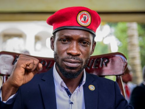 Opposition presidential challenger Bobi Wine, whose real name is Kyagulanyi Ssentamu, gestures as he speaks to the media outside his house, in Magere, near Kampala, in Uganda Tuesday, Jan. 26, 2021. An attorney for Bobi Wine says Ugandan soldiers have withdrawn from the opposition presidential challenger's home the day after a judge ruled that his house arrest was unlawful. But the attorney tells The Associated Press that security forces can still be seen in the village near the candidate's property outside the capital, Kampala. (AP Photo/Nicholas Bamulanzeki)