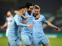 Manchester City's Ilkay Gundogan, centre, celebrates his opener in the win at West Brom (Nick Potts/PA)