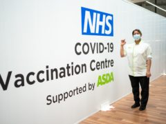 A qualified Asda pharmacy colleague holding a dose of the coronavirus vaccine at an Asda in West Bromwich (Asda/PA)
