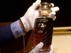 A 72-year-old bottle of Glen Grant single malt whisky from Scotland displayed at a Bonhams auction preview in Hong Kong (Vincent Yu/AP)
