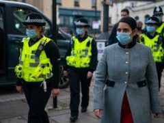 Home Secretary Priti Patel during a foot patrol with new police recruits around Bishop's Stortford, Hertfordshire. Picture date: Thursday January 28, 2021. (Aaron Chown/PA)