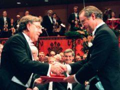 Dutch Professor Paul J Crutzen, left, receiving the Nobel Prize for chemistry from Swedish King Carl XVI Gustaf at the Concert Hall in Stockholm, Sweden, in 1995 (Eric Roxfelt/AP)
