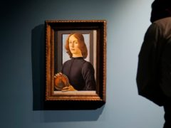 Sandro Botticelli's painting called Young Man Holding A Roundel is displayed at Sotheby's in New York (Seth Wenig/AP)