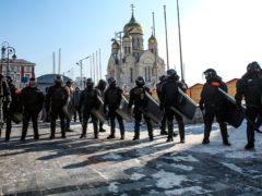 Police officers block entry to the central square in Vladivostok, Russia (Aleksander Khitrov/AP)