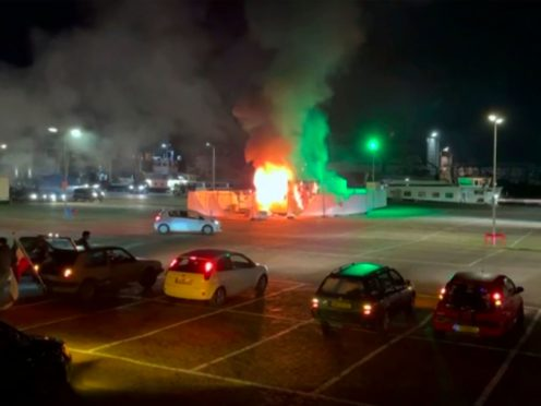 In this image made from video, a COVID-19 testing center is seen after being set on fire in Urk, 80 kilometers (50 miles) northeast of Amsterdam, Saturday, Jan. 23, 2021. Dutch police have clashed with protesters demonstrating against the country's lockdown in the capital, Amsterdam and the southern city of Eindhoven. The unrest comes a day after rioting youths protesting on the first night of the country's curfew torched a coronavirus testing facility in Dutch fishing village Urk. (Pro News via AP)