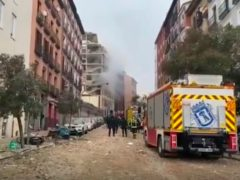 Firefighters attend the scene after an explosion in Madrid (Emergencias Madrid via AP)
