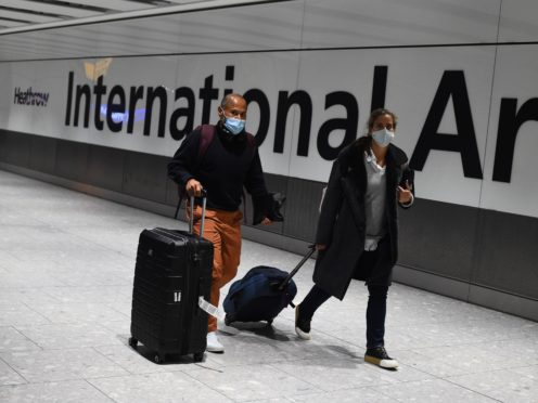 It is not clear when international travel will be able to resume more widely, Fergus Ewing said. (Kirsty O'Connor/PA)