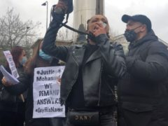 Bianca Ali addresses a protest outside Cardiff Bay police station (Adam Hale/PA)