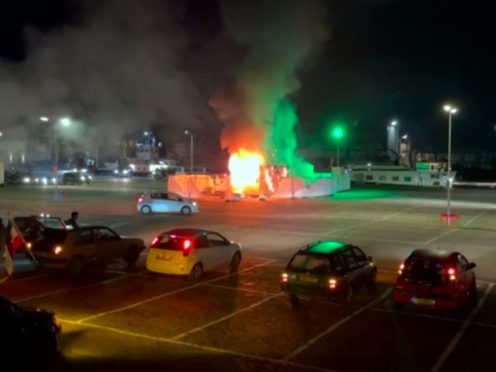 A Covid-19 testing centre is set on fire in Urk (Pro News via AP)