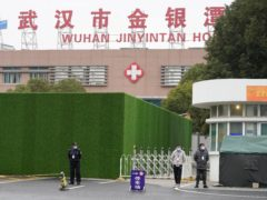 Security personnel guard an entrance to the Wuhan Jinyintan Hospital where a team from the World Health Organisation visited (Ng Han Guan/AP)