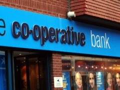 The Co-operative Bank said it is on track to return to profit (PA)