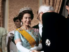 The Queen meeting guests at a banquet given by Grand Duke Jean of Luxembourg in 1976 (Ron Bell/PA)