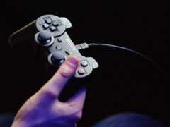 A man holds a Playstation 3 controller at a preview event for Star Trek: the Video Game, at the Science Museum, in central London