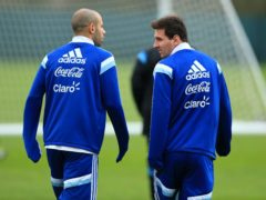 Javier Mascherano is not about to give any advice to former Argentina and Barcelona team-mate Lionel Messi (right) over his future (Mike Egerton/PA)