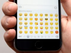 A generic stock photo of Emojis on an Apple iPhone 6s.