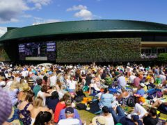 A general view of spectators watching centre court action from Murray Mound at Wimbledon (Adam Davy/PA)