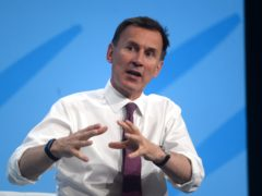 Jeremy Hunt said he broke his arm while jogging on icy roads (PA)