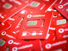 Vodafone dragged the FTSE 100 up but GSK pulled it back down (Matt Alexander/PA)