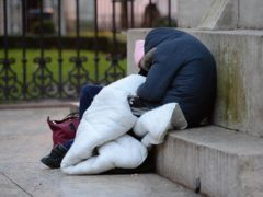 Homeless people sleep on the plinth of the Ferdinand Foch equestrian statue in Victoria, London (Nick Ansell/PA)