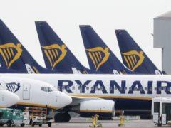 Ryanair has announced a third quarter loss (Niall Carson/PA)