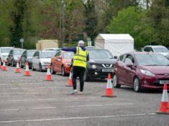 Cars queued at a coronavirus testing site (Aaron Chown/PA)