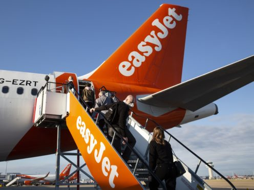 Airlines and travel firms are experiencing a surge in demand following Boris Johnson's road map for how coronavirus restrictions will be eased in England (Matt Alexander/PA)