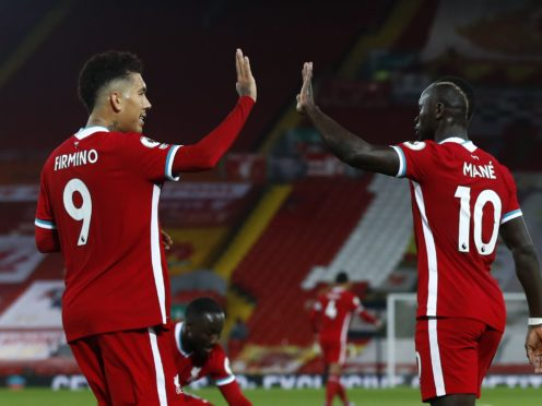 Sadio Mane believes life would be harder for him and Mohamed Salah were it not for the work of fellow forward Roberto Firmino (Jason Cairnduff/PA)