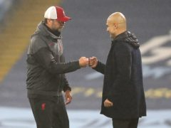 """Pep Guardiola, right, has expressed sympathy for the """"exceptional"""" Jurgen Klopp (Martin Rickett/PA)"""