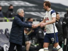 Jose Mourinho, left, shakes hands with Harry Kane (Ian Walton/PA)