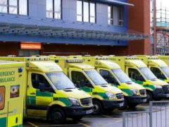Ambulances lined up outside the Medway Maritime Hospital in Gillingham, Kent, one of the areas where hospitals have become stretched due to the faster spreading new strain of Covid-19.