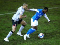 Peterborough's Siriki Dembele (right) has been passed fit to return to action following injury (Tim Goode/PA)