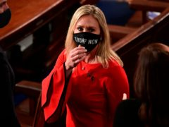 """Marjorie Taylor Greene wears a """"Trump Won"""" face mask as she arrives on the floor of the House to take her oath of office on opening day of Congress last month (Erin Scott/Pool/AP)"""