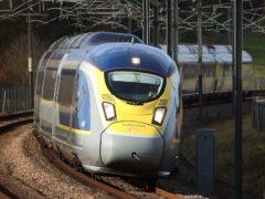 A Eurostar e320 high-speed train heads towards France through Ashford in Kent (Gareth Fuller/PA)