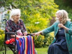 Hand-holding will be allowed in care homes from March 8, under Government plans (Dominic Lipinski/PA)