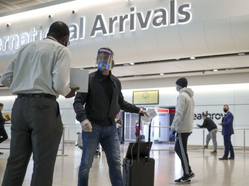 The Government is set to announce that all travellers arriving in the UK will be required to take two coronavirus tests while they quarantine (Steve Parsons/PA)