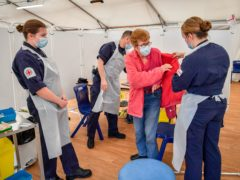 Royal Navy personnel give vaccines to the public at Bath Racecourse (PA)