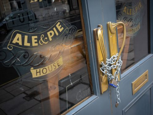 Chains secure the doors of a closed Fuller's pub in London, during England's third national lockdown (Dominic Lipinski/PA)