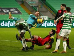Jak Alnwick in action against Celtic (Andrew Milligan/PA)