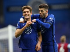 Christian Pulisic, right, celebrates with Marcos Alonso after teeing up his Chelsea team-mate's goal against Burnley (Julian Finney/PA)