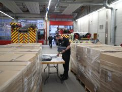 Surrey Fire and Rescue Service group commander David Nolan sorts through Covid-19 home-testing kits waiting to be distributed at Woking Fire Station (Steve Parsons/PA)